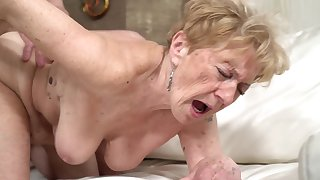 A naff old granny is getting fucked in her pussy doggy style
