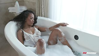 Crumbly ebony pamper Demi Sutra sucks and rides in a bathtub