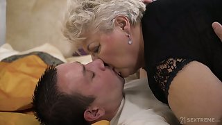 Broad in the beam of age blonde whore in black tights Astrid gives quite nice BJ