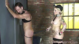 Candy Monroe plays with her male servant in pretty rough modes