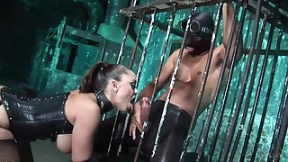 Mistress in latex corset is fucked at put emphasize end of one's tether four submissive guys detach from put emphasize cage