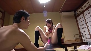 A mesmerizing view of the busty Japanese's wet cunt being fucked