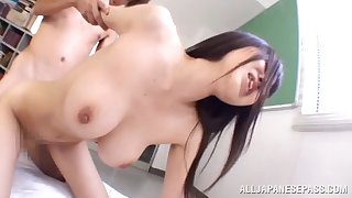 Japanese cutie with big tits takes a big cock deep close to her furry furnace