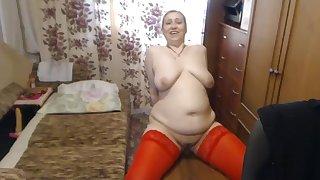 Curvy mature woman rides dildo