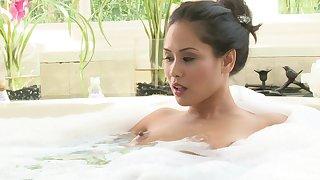 Asian pornstar Jessica Bangkok gives a blowjob and earns cum above tits